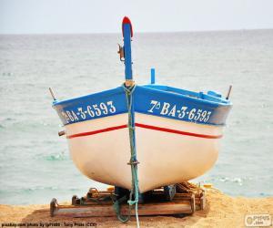 puzzel Boot aarding op het strand