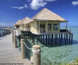 puzzel Cottages op de zee