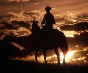 puzzel Cowboy rijden in de schemering