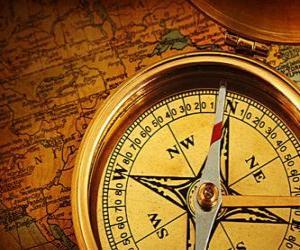 puzzel De kaart en kompas een aantal essentiële accessoires voor de ontdekkingsreizigers en avonturiers