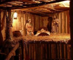 puzzel De kerststalbeeldjes in een klein houten gebouw