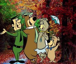 puzzel De protagonisten van de avonturen: Yogi Beer, Boo-Boo, Cindy en de parkwachter Smith