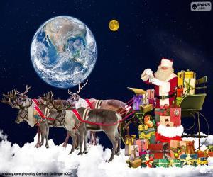 puzzel De slee van de Kerstman over de wolken