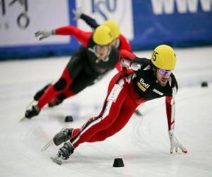 puzzel Drie schaatsers in een wedstrijd schaatsen