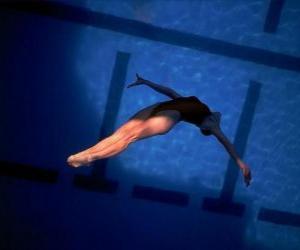 puzzel Een vrouwelijke duiker sprong voorwaarts