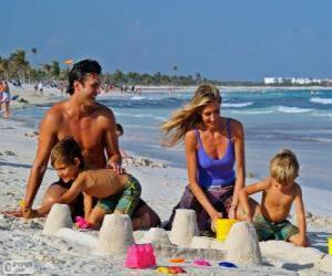 puzzel Familie op het strand