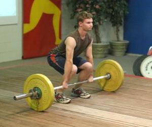 puzzel Gewichtheffen - gewichtheffer in het begin van de oefening