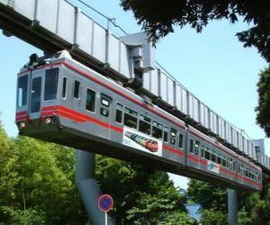 puzzel Hangende monorail. Passagiers van de monorail genieten van het uitzicht op de kermis