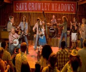 puzzel Hannah Montana (Miley Cyrus) uitvoeren van een van zijn liederen in Crowley Corners, de stad die geboorte gaf aan Miley.