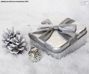 puzzel Het gift van Kerstmis op de sneeuw