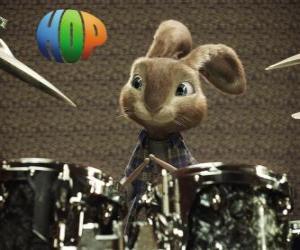 puzzel Het konijn Hop met de drumsticks om muziek te maken met het drumstel