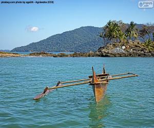 puzzel Houten kano op de kust van Afrika