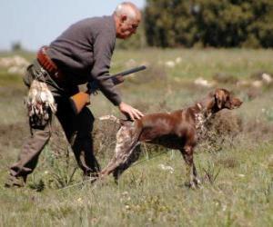 puzzel Hunter jagen met zijn hond
