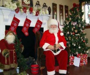 puzzel Kerstman zit van het huis van de brand of de open haard