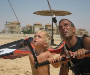 puzzel Kinderen doen vliegeren met zijn vader