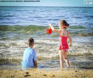 puzzel Kinderen genieten van het strand