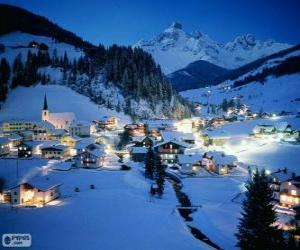 puzzel Kleine stad volledig ondergesneeuwd op kerstavond