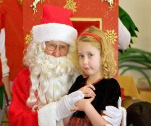 puzzel Meisje praten met de kerstman zittend op zijn schoot
