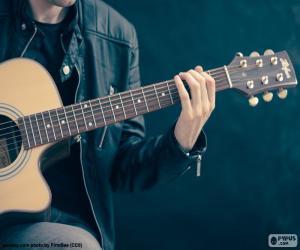 puzzel Muzikant, gitaar spelen