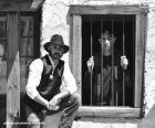 Oude sheriff met een cowboyhoed en een ster op zijn borst