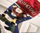 Kerst sok met ornamenten en presenteert