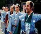 Samurai met traditionele kleding, wijde broeken en kimono