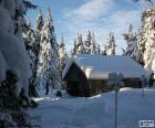 Cabine van hout een zware sneeuwval