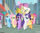 De pony's bij de aankomst in Manehattan met ladingen van bagage op sleeptouw