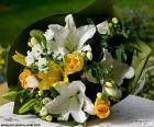 Boeket voor de bruid gemaakt met verschillende bloemen