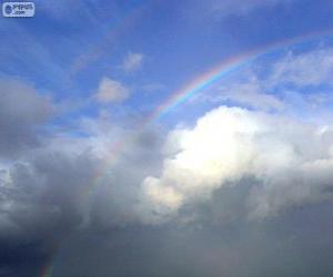 puzzel Regenboog tussen wolken