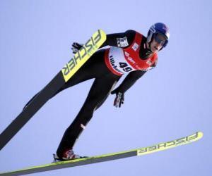puzzel Skier midden in de vlucht door te springen van een trampoline