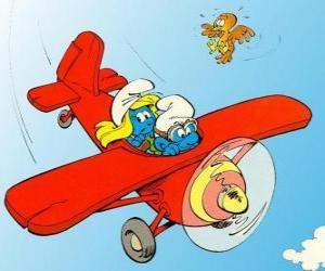 puzzel Smurf en Smurfin een vliegende een rode vliegtuig
