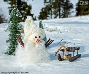 puzzel Sneeuwpop en slee