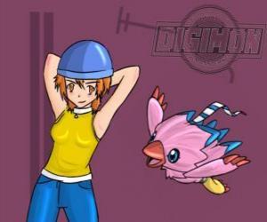 puzzel Sora speelt met haar Digimon Biyomon. Sora Takenouchi is de meest verantwoorde en volwassen van de groep
