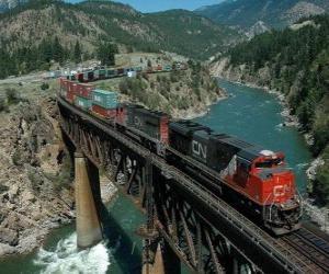 puzzel Trein van goederen die over een brug