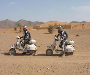 puzzel Twee avonturiers op een motorfiets