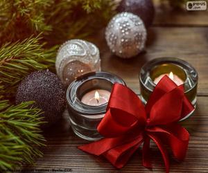 puzzel Twee kaarsen met een rood lint
