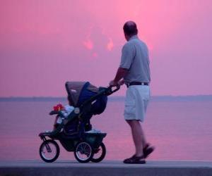 puzzel Vader met zijn zoon naast de zee wandelen