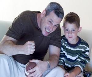 puzzel Vaders en zoon genietend van een match
