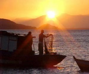 puzzel Vissers bij zonsondergang