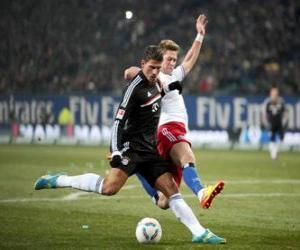 puzzel Voetbalster op het moment van het schoppen van de bal